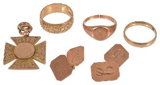 An Edwardian 9ct rose gold floral engraved wedding band and others,