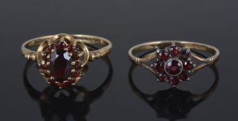 A gold mounted Bohemian garnet set daisy cluster ring,