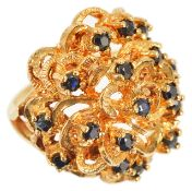 A contemporary 9ct gold and sapphire set bombe ring