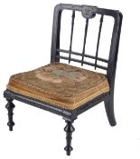 A Victorian ebonised doll's chair,