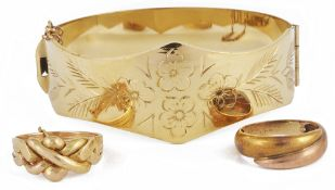 A four section gold puzzle ring,