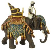A large contemporary cold painted bronze figure of elephant and rider after Bergman