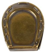 A brass vesta in the form of a horse shoe