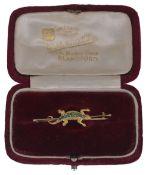 A Victorian 15ct gold and demantoid green garnet lizard bar brooch,