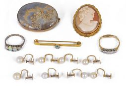 A 9ct gold mounted oval moss agate brooch and a collection of related items,