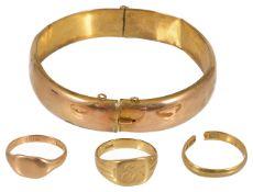 A 9ct gold hinged bangle
