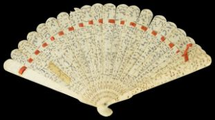 A carved late 19th century Chinese ivory fan