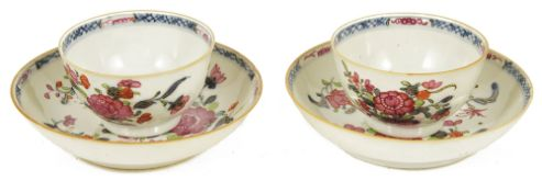 A pair of Chinese 18th century famille rose tea bowls and saucers