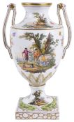 A late 19th century Continental twin handled porcelain urn