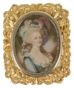 An unusual gold framed, gem set portrait pendant brooch