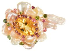 An unusual Continental gold mounted baroque pearl and coloured gem floral brooch