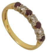 A ruby and diamond set seven stone half eternity ring,
