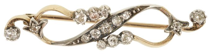A delicate diamond set ribbon scroll brooch, circa 1900