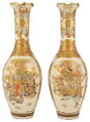 A pair of late 19th century Japanese Satsuma vases of slender neck baluster form,