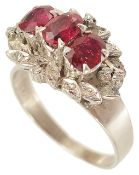 A Continental three stone ruby and diamond set cocktail cluster ring,