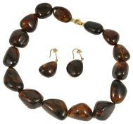 A treacle coloured young amber bead necklace and ear drops
