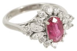 An attractive Continental ruby and diamond oval fancy cluster ring