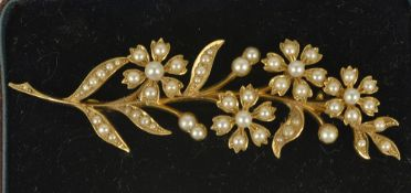 A Victorian pearl set floral spray brooch