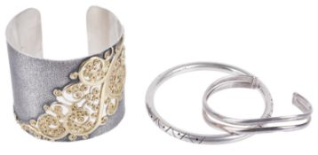 An attractive contemporary silver cuff bracelet and two silver bracelets