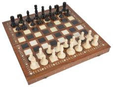A late 19th/early 20th century coromandel and ivory chess set and later boardthe turned ivory and