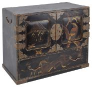 A Meji period Japanese lacquer kodansu (cabinet)with doors to the front decorated with birds and