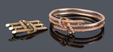 A Victorian style diamond, sapphire, ruby and pearl bangle and the matching broochboth pieces marked