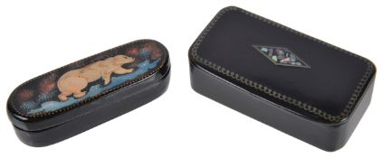 Two paper mache snuff boxesthe first a Russian box of elongated oval form decorated with polar bear,
