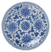 A large Chinese 19th century blue and white charger well painted with scrolling anemones and