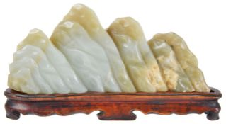 A Chinese late 19th century carved jade scholars mountainmounted on fitted carved hardwood stand