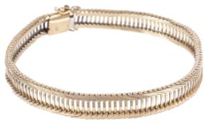 A 9ct gold articulated 'strap' bracelet, circa 1960the centre of pierced ladder link construction,