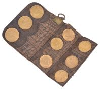 A coin wallet containing three full fine gold sovereigns and six half sovereignscomprising three