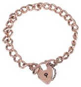 A rose gold curb link bracelet with heart padlock fasteningeach link stamped 9ctapprox. weight 10.