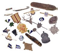 A collection of military and civil badges and insignias and othersincluding a silver London Rifle