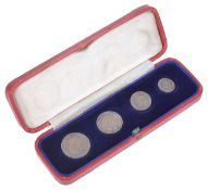 A cased set of four Maundy Money coins dated 1933 in fitted case, (4)Condition: Fair to good with
