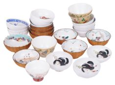 A mixed collection of early 20th century Japanese saki bowlswith various painted scenes including