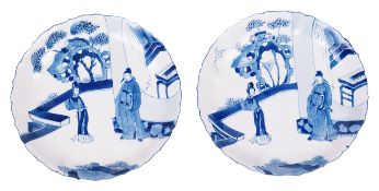 A pair of Chinese Kangxi blue and white porcelain dishescirca 1700each decorated with figures in a
