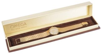 An 18K Omega ladies manual wind wristwatchthe circular champagne dial with baton and numerical