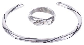 A Georg Jensen silver torque bangle and a similar Jensen ring, post 1945each piece fully marked,