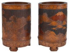 A pair of early 20th century Chinese bamboo brush potsthe cylindrical pots carved in relief with
