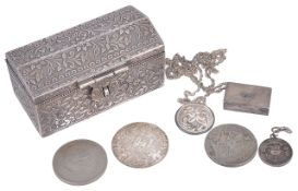 A 20th century white metal casket possibly Persianof sarcophagus shape decorated with flowers,
