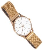 A 9ct gold Garrard automatic gentlemans wristwatchthe champagne dial with baton hours and hands,