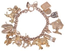 A heavy rose gold curb link charm braceletthe 9ct gold bracelet hung with an interesting variety