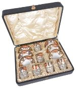 A Royal Crown Derby set of six silver mounted coffee cups and saucers