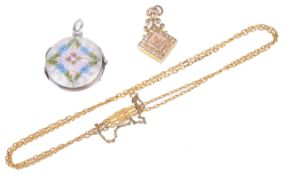 A delicate continental guilloche hinged enamel picture locket having central rose within foliate