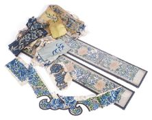 A pair of 19th century Chinese sleeve panelstogether with a small collection of unframed Chinese