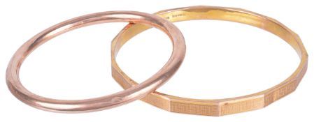 An early 20th century 9ct gold gold 'slave' bangle and a rose gold banglethe arm bangle with key
