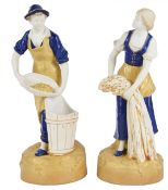 A pair of Royal Dux figurines of a young boy and girl gathering fruit and wheat