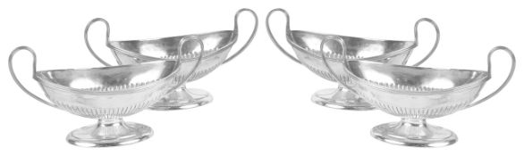 A set of four Victorian silver salts, hallmarked London 1895the twin handled navette shaped pedestal