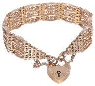 A fancy gold four bar gate bracelet with heart padlock fasteningthe bracelet of substantial