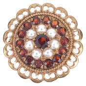A gold mounted garnet and pearl set cluster broochthe circular brooch having central garnet within a